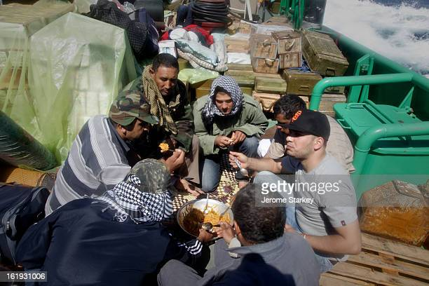 CONTENT] Libyan rebels huddle round a bowl of pasta on board a tug boat laden with ammunition to break the siege of Misrata May 13 2010 The 29m tug...