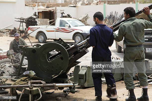Libyan rebels inspect the remains of a Russian antiaircraft gun at a workshop in Benghazi where civil engineers are working alongside a defected...