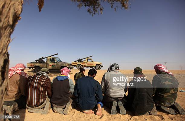 Libyan rebels pray on March 27 2011 near Ajdabiya which was the scene of fierce fighting the day before and what locals describe as a brutal siege by...