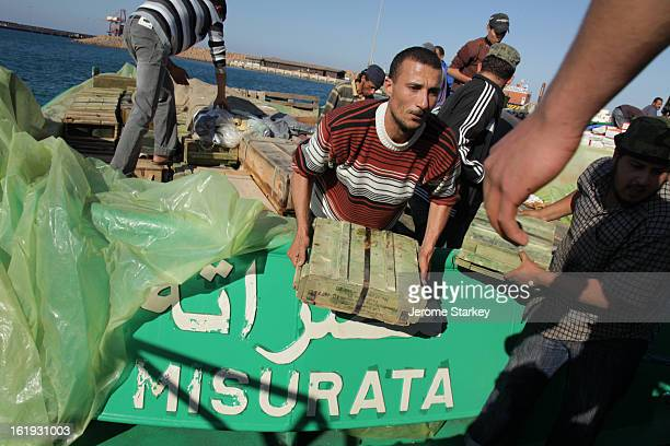 Libyan rebels unload a tug boat laden with weapons and ammunition at the port in Misrata, where they have been under siege by Colonel Gaddafi's...