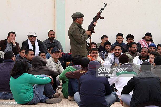 Libyan recruits are given instruction on the AK47 assault rifle at a Libyan rebel training camp on March 15 2011near Benghazi Libya Rebel forces in...