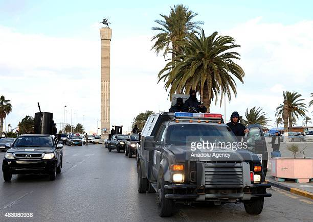 Libyan security forces gather with the military vehicles and ammunition at the Martyrs' Square to go their duty places after new security plan put...