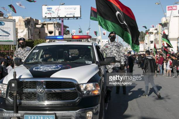 Libyan security forces parade during celebrations of the 10th anniversary of Libyan Revolution, known as the 17 February Revolution, which ousted...