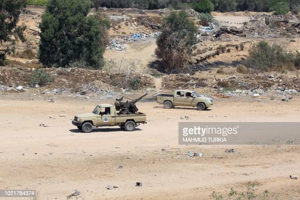 Libyan security forces patrol an area on August 23 2018 near the site of an attack on a checkpoint in the city of Zliten 170 km east of the capital...