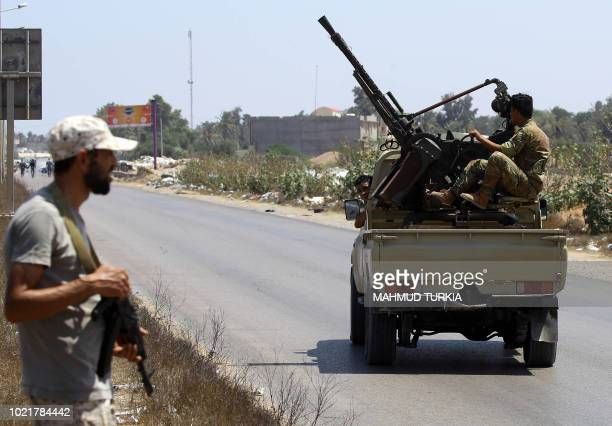 Libyan security forces patrol on August 23 2018 near the site of an attack on a checkpoint in the city of Zliten 170 km east of the capital Tripoli...