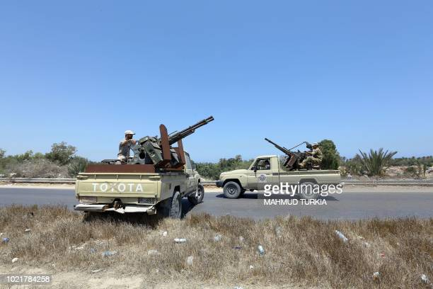 Libyan security forces stand guard at a checkpoint on August 23 2018 at the site of an attack on a checkpoint in the city of Zliten 170 km east of...