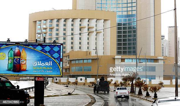 Libyan security forces take security measures around the Corinthia Hotel on January 27 2015 after a car bomb exploded outside the largest hotel in...