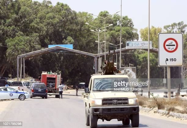 Libyan security patrol on August 23 2018 near the site of an attack on a checkpoint in the city of Zliten 170 km east of the capital Tripoli An...