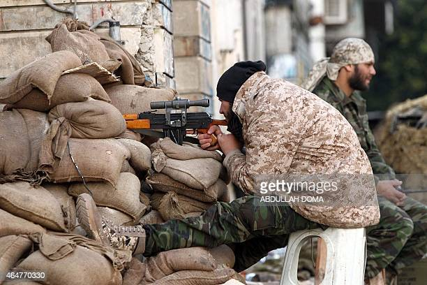 A Libyan soldier loyal to Libya's internationally recognised government of Abdullah alThani and General Khalifa Haftar monitors a street from his...