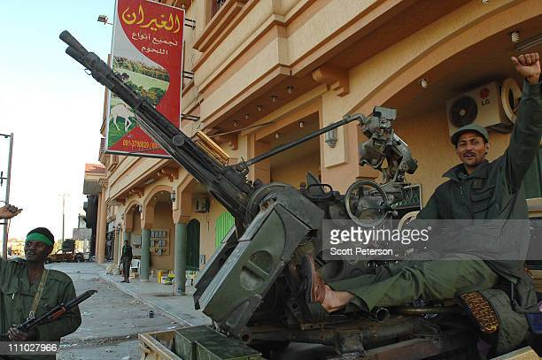 Libyan soldiers and militiamen men loyal to Muammar Gadaffi show they have control of part of Tripoli Street in the rebel-held enclave on March 28,...
