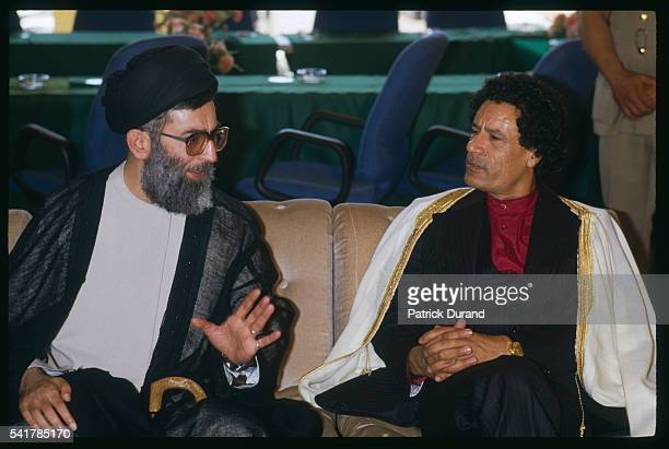 Libyan Statesman Moammar Kadhafi and Iranian President Ali Khamenei speak together at the eighth Summit of NonAligned Countries Driven by the need to...