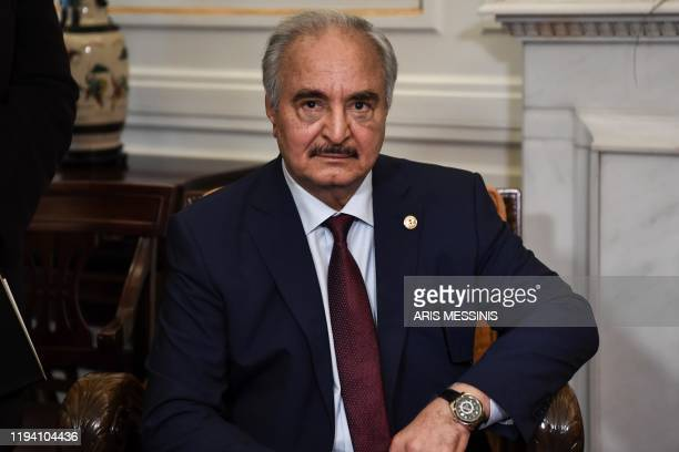 Libyan strongman Khalifa Haftar sits during talks with Greek Foreign Minister in Athens, on January 17 days ahead of a peace conference in Berlin...