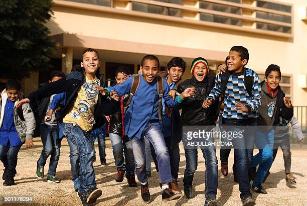 TOPSHOT Libyan students play in the courtyard of the alBashayer school in the eastern coastal city of Benghazi on December 13 as they come back to...