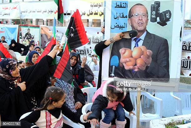 Libyan women place a shoe on a placard bearing a portrait of UN envoy for Libya Martin Kobler during a demonstration against a UNsponsored agreement...