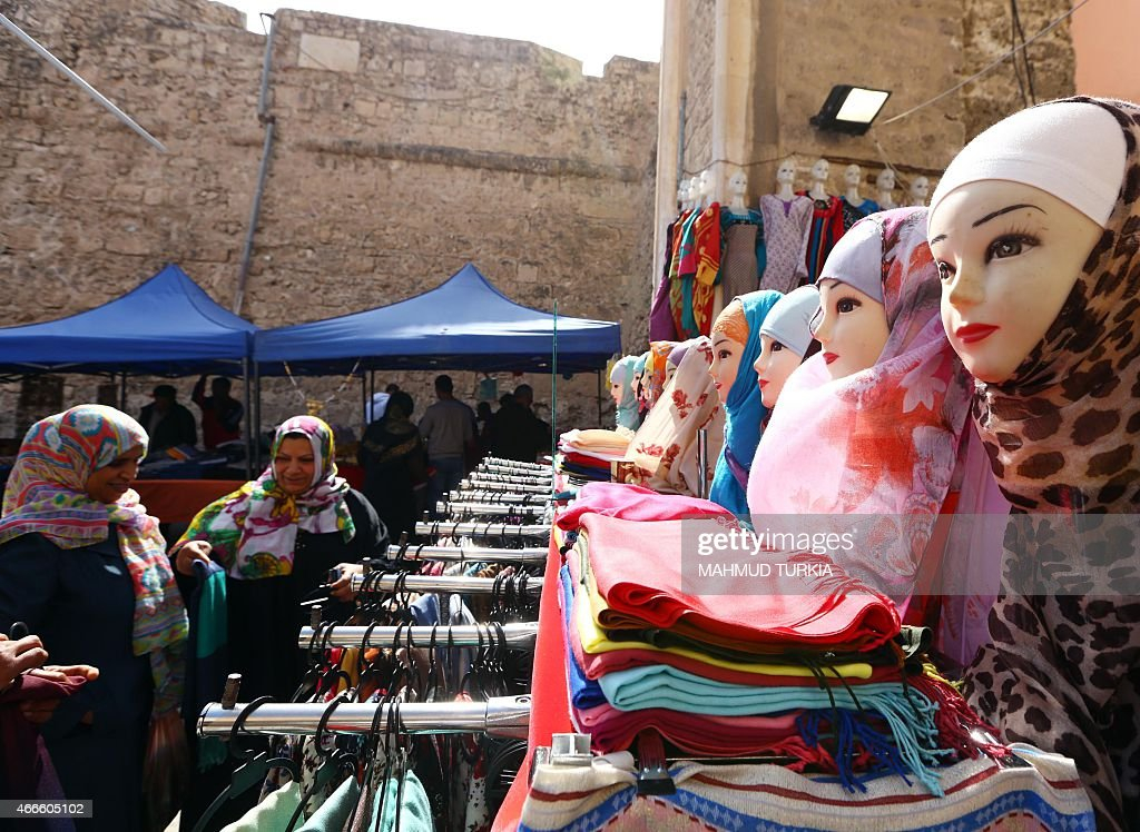 Libyan women shop in the old part of the capital, Tripoli, on March 17, 2015.