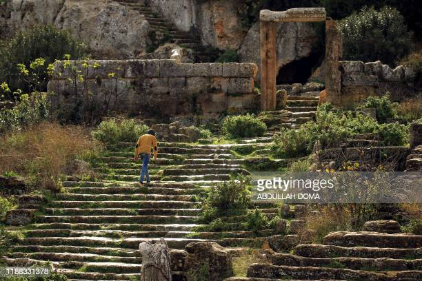 A Libyan youth climbs stairs as he practices parkour on the site of the ancient Greek city of Cyrene founded in 630 BC as a colony of Thira on the...