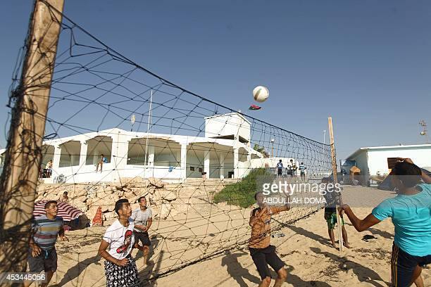 Libyan youth play volleyball along the beach at a summer camp for scouts in the eastern Mediterranean coastal city of Benghazi on August 10 2014 AFP...