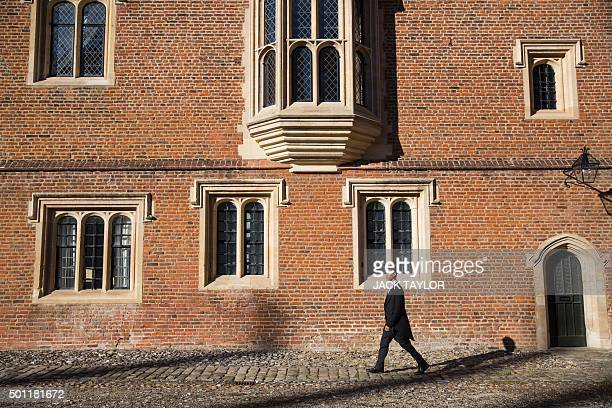 Libyanborn student Ammar Mustapha poses for a photograph at Eton College in Eton west of London on October 1 2015 Wearing a white tie and coat tails...