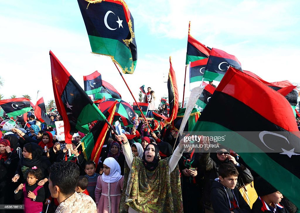 Libyans celebrate in Tripoli's landamark Martyrs square on February 17, 2015 the upcoming fourth anniversary of the Libyan revolution which toppled strongman Moamer Kadhafi. Islamist militants have thrived in Libya since Kadhafi was toppled and killed in the NATO-backed 2011 uprising, with authorities struggling to contain dozens of militant groups with diverse motivations and ideologies.