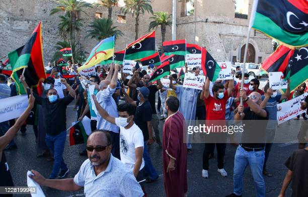 Libyans chant slogans during a demonstration due to poor public services at the Martyrs' Square at the centre of the GNA-held Libyan capital Tripoli...