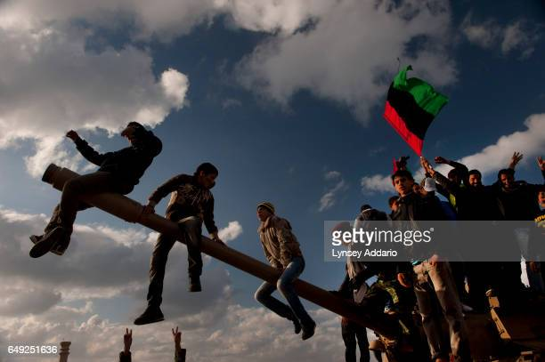 Libyans demonstrate against Col Muammar alGaddafi in Benghazi Libya Feb 26 2011 Dangerous confrontations have been going on between opposition forces...