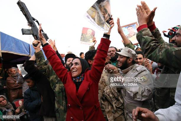 Libyans demonstrate in support of eastern Libya's troops commanded by military strongman Khalifa Haftar on March 17 2017 in Benghazi Dozens of armed...
