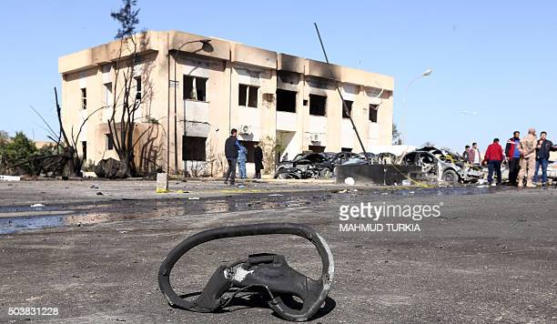 Libyans gather at the site of a suicide truck bombing on a police school in Libya's coastal city of Zliten some 170 kilometres east of the capital...