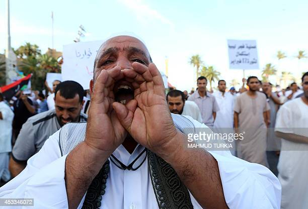 Libyans gather during a protest against Libya's new nationalistdominated parliament that is based in the city of Tobruk on August 8 in the capital...