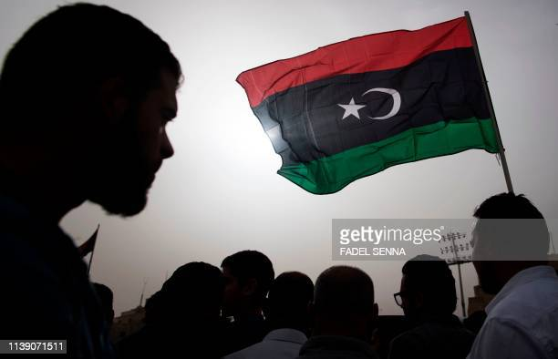 Libyans gather during the funeral of fighters loyal to the Government of National Accord in the capital Tripoli, on April 24 after they were...