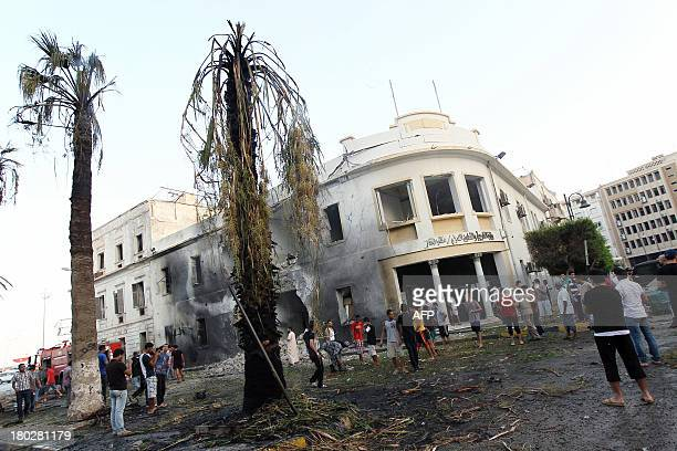 Libyans gather outside a foreign ministry building that was damaged by a powerful blast on September 11 2013 in the eastern Libyan city of Benghazi...
