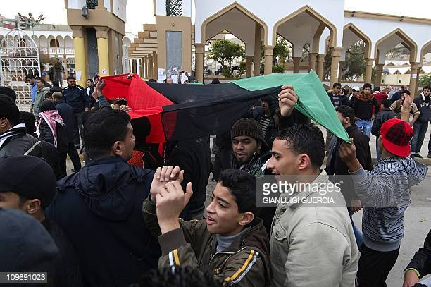 Libyans protest in the eastern Libyan town of Derna between Tobruk and Benghazi on February 23 2011 amid reports that Moamer Kadhafi's regime has...