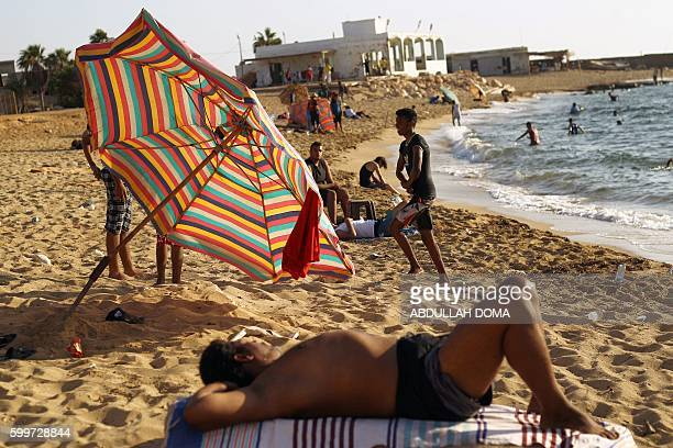 Libyans rest and swim at a beach in the eastern coastal Libyan city of Benghazi on September 6 2016 / AFP / Abdullah DOMA