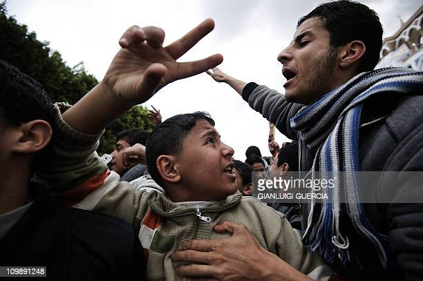 Libyans shout antiKadhafi slogans during a demonstration in the eastern Libyan town of Derna between Tobruk and Benghazi on February 23 2011 amid...