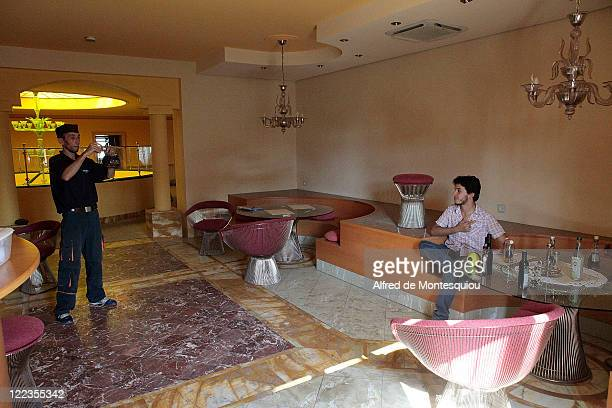 Libyans take pictures in one of the dining rooms in Aisha Gaddafi's luxury villa on August 27 2011 in Tripoli Libya Houses belonging to the Libyan...