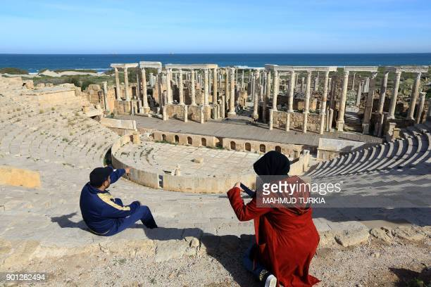 Libyans visit the theatre in the ruins of the ancient Roman city of Leptis Magna in alKhums 130 kilometres east of the Libyan capital Tripoli on...