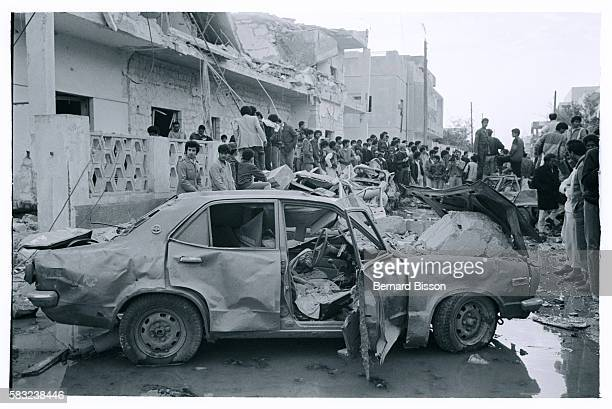 Libyans walk through the streets of their city and look at the ruins destroyed cars and damage caused by the punitive American bombings of the cities...