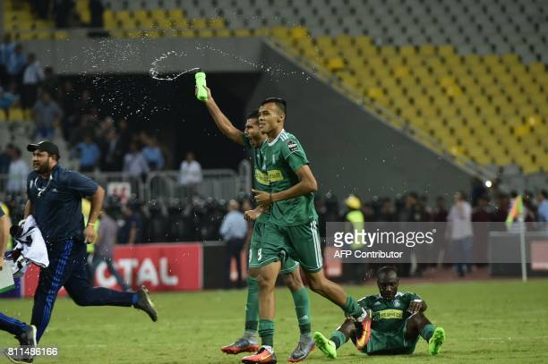 TOPSHOT Libyas Al Ahly Tripoli footballers celebrate at the end of their match against Egypt's Zamalek during their African Champions League group...