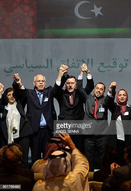 Libya's General National Congress deputy president Saleh alMakhzoum the new national government head Prime Minister Fayez alSarraj and the head of...