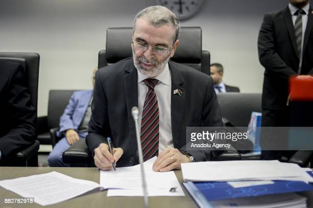 Libya's head of National Oil Corporation Mustafa Sanalla signs a document during the 173rd Ordinary Meeting of the Organisation of Petroleum...