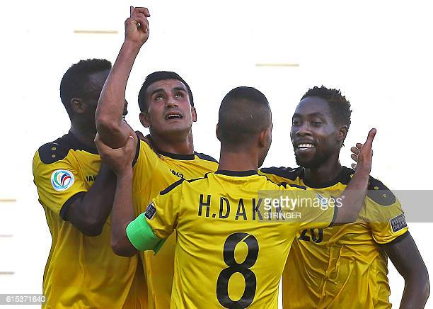 Libya's Hussein Dakik and teammates celebrate scoring a goal during the 2016 Asian Football Confederation Cup semifinal second leg football match...