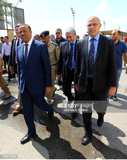 Libya's interim Premier Abdullah alThini Chief of Staff of the Libyan Armed Forces MajorGeneral Abdulsalam Jadallah and Britain's Ambassador to Libya...