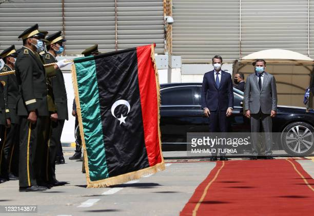 Libya's interim prime minister Abdul Hamid Dbeibah and Greece's Prime Minister Kyriakos Mitsotakis review a guard of honour in the Libyan capital...