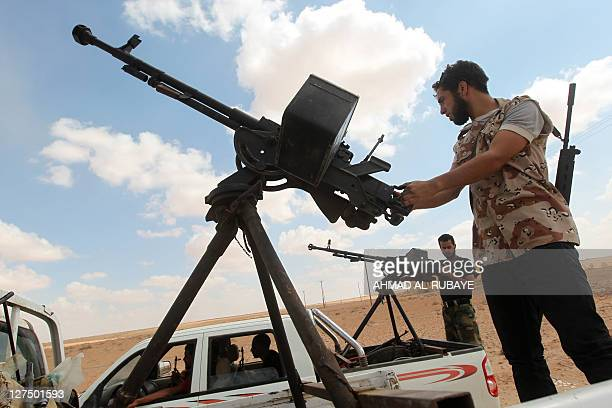 Libya's National Transitional Council fighters take position in the outskirts of Sirte on September 28 2011 AntiKadhafi forces urged NATO to...
