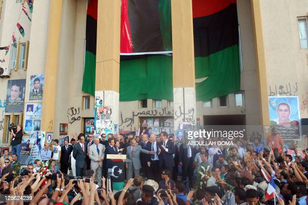 Libya's National Transitional Council leader Mustafa Abdel Jalil stands between France's President Nicolas Sarkozy and Britain's Prime Minister David...