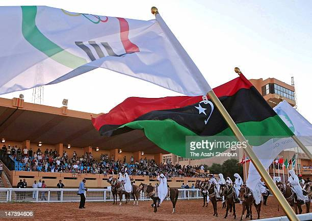 Libya's new national flag and its Olympic flag flutter during the opening ceremony of the Global Peace Game on June 27, 2012 in Tripoli, Libya. 8,000...