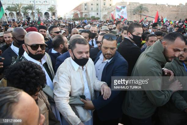 Libya's Prime Minister Abdul Hamid Dbeibah arrives at the Martyrs Square in the capital Tripoli to celebrate the 10th anniversary of the 2011...