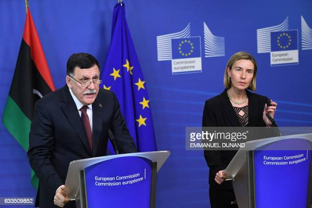 Libya's Prime Minister Fayez al-Sarraj and European Commission foreign policy chief Federica Mogherini address a press conference at the European...