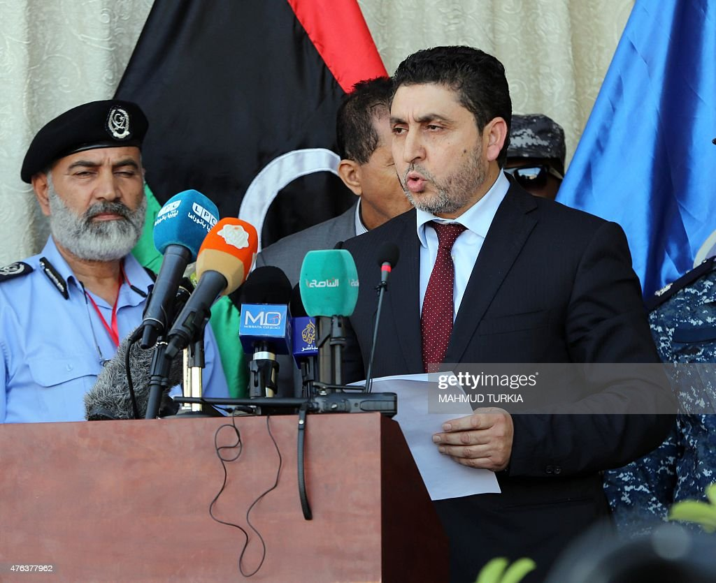 Libya's Prime Minister of the self-declared Islamist-backed government in Tripoli, Mohammed Khalifa al-Guwail, speaks during a special graduation ceremony for police personnel on June 8, 2015 at Martyr's Square in Tripoli. Libya has had two governments and parliaments since Tripoli was seized in August by Fajr Libya, an Islamist-backed militia alliance. The official internationally recognised government is now based in the country's far east.