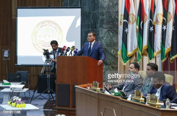 Libya's prime minister-designate Abdul Hamid Dbeibah addresses lawmakers during the first reunited parliamentarian session, in the coastal city of...