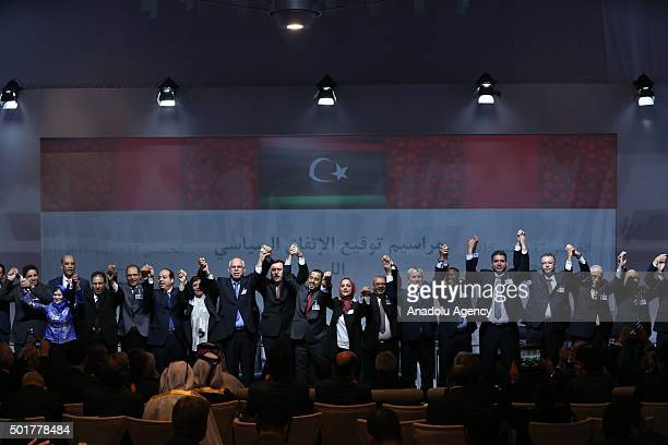 Libya's Tobrukbased government's representative Muhammed Shuayb gestures after signing the 'Libyan Political Agreement' in Suheirat Morocco on...